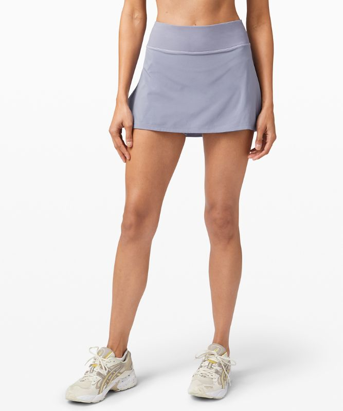 Play Off The Pleats Mid Rise Skirt