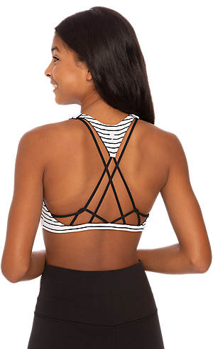 315adc5f98f The back of a girl wearing a black and white bra, featuring a strappy open